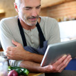 Mature man in kitchen — Stock Photo