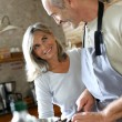 Senior couple preparing dinner — Stock Photo #35322273