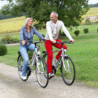 Senior couple riding bicycle — ストック写真