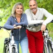Senior couple with bicycle — Stock Photo #35323195