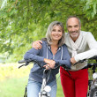Senior couple with bicycle — Stock Photo