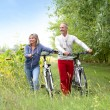 Senior couple with bicycle — Stock Photo #35323253