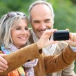 Senior couple taking picture — Stock Photo #35323759
