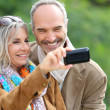 Senior couple taking picture — Stock Photo