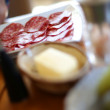 Plate with slices of sausage — Stockfoto