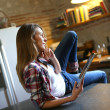 Hipster girl websurfing on tablet — Stock Photo