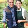Couple standing in kitchen garden — Stock Photo #35326209