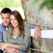 Lovers relaxing on bench — Stock Photo #35326711