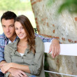 Lovers relaxing on bench — Stock Photo