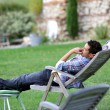 Stock Photo: Man relaxing in home garden