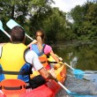 Couple in canoe — Stock Photo #35327279