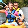 Couple in canoe — Stock Photo