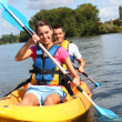 Couple in canoe — Stock Photo #35327467