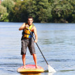 Stock Photo: Mriding stand-up-paddle
