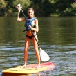 Stock Photo: Womriding stand-up-paddle