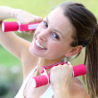 Woman in park with dumbbells — Stock Photo