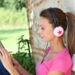 Young woman enjoying music — Foto Stock