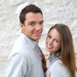 Couple standing in front of wall — Stock Photo