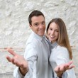 Couple standing in front of wall — Stock Photo #35329181