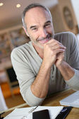 Mature man working from home — Stock Photo
