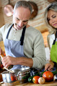 Senior couple preparing dinner — Stock Photo