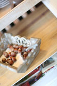 Hazelnuts on kitchen table — Stock Photo