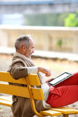 Senior man relaxing on bench — Stock Photo