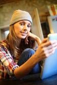 Hipster girl websurfing on tablet — Stock Photo