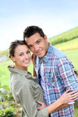 Sweet couple in countryside — Stock Photo