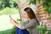 Girl connected on internet in country — Stock Photo