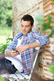 Man on bench with smartphone — Stock Photo