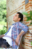 Man relaxing on bench — Stock Photo