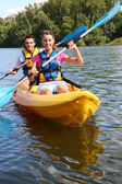 Couple in canoe — Stock Photo