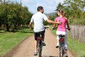 Couple riding bicycles — Stock Photo