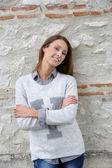 Girl leaning on wall — Stock Photo