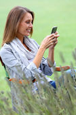 Woman using mobile phone — Stock Photo