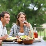 Couple having lunch in hotel garden — Stock Photo #35331111