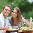 Couple having lunch in hotel garden — Stock Photo