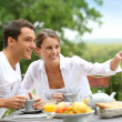 Couple having breakfast in garden — Stock Photo #35331305