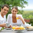 Couple having breakfast in garden — Stock Photo #35331335