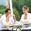 Couple having breakfast in garden — Stock Photo