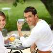 Couple having breakfast in garden — Stock Photo #35331449