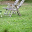 Chairs set in garden — Stock Photo