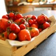 Box of fresh tomatoes — Stock Photo