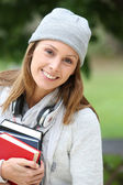 Student walking in park — Stock Photo