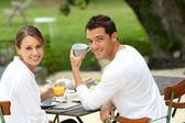 Couple having breakfast in garden — Stock Photo