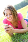 Girl sending message with smartphone — Stock Photo