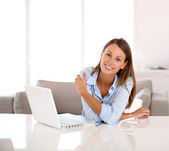 Woman working from home on laptop — Stock Photo