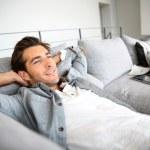 Man relaxing on sofa — Stock Photo