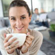 Woman drinking hot tea — Stock Photo #36645595